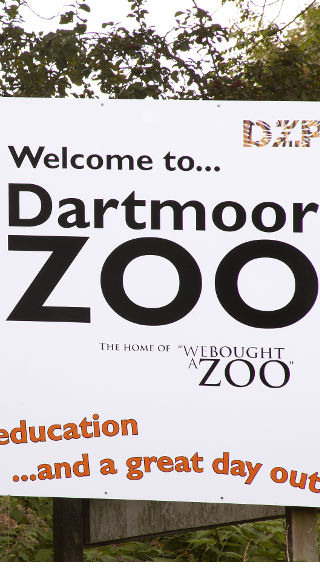 Welcome sign of the Dartmoor zoo restaurant lit by Philips Lighting