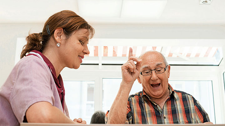 A patient and staff enjoying the clear vision at Elderly Care Home, Germany, illuminated by Philips Lighting